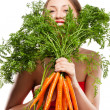 Attractive woman holds bunch of carrots — Stock Photo #6301892