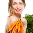 Attractive woman holds bunch of carrots — Stock Photo