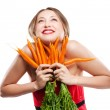 Attractive woman holds bunch of carrots — Stock Photo #6302879
