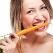 Blonde woman eating carrot — Stock Photo #6303002