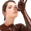 Royalty-Free Stock Photo: Woman covered sweet cream chocolate