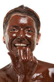 Young woman having a chocolate face mask — Stock Photo
