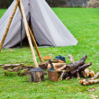 Campfire with old tent - Stock Photo