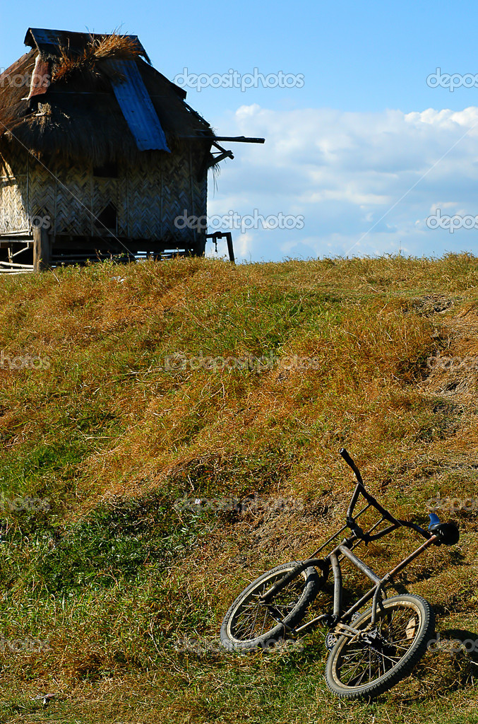 Owner of bicycle inside small hut  Stock Photo #6272546