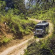 Jeep on Dirt Road - Stock Photo