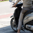 Stock Photo: Female on moped