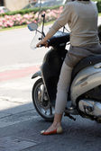 A female on a moped — Stock Photo