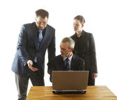 Three persons in an office. — Stock Photo