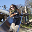 Girl on the slide — Stock Photo