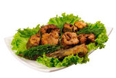 Fried fish on lettuce — Stock Photo