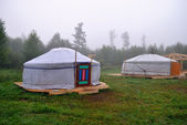 Two Buryat yurt in the background of the misty morning — Stock Photo