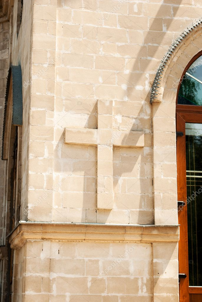 A fragment of the facade wall with architectural detail in the shape of cross. — Stock Photo #6151438
