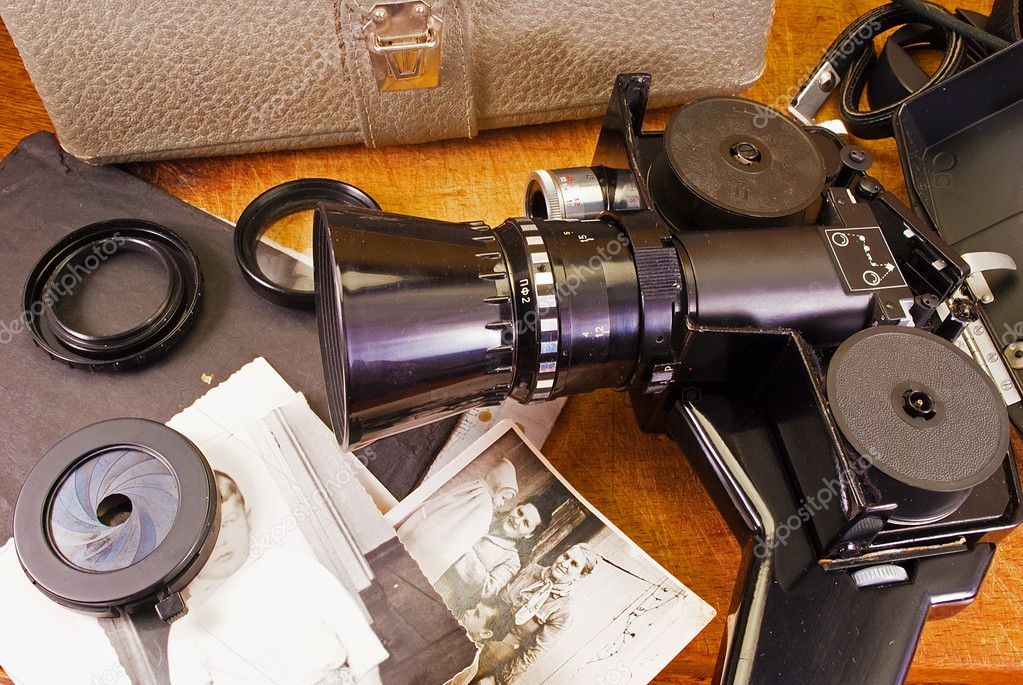 Vintage video camera, accessories and old photo. — Stock Photo #6691651