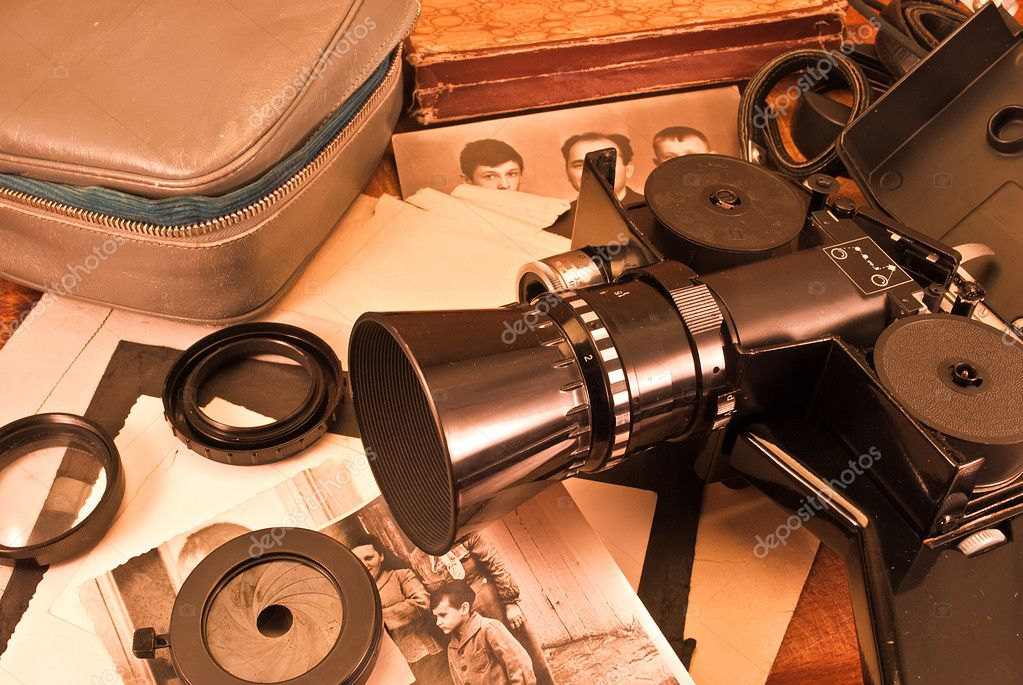 Vintage video camera, accessories and old photo. — Stockfoto #6691659
