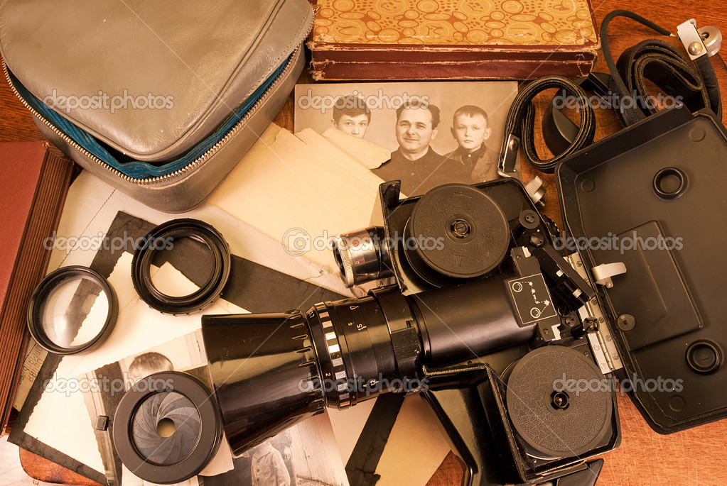 Vintage video camera, accessories and old photo.  Stock Photo #6691669