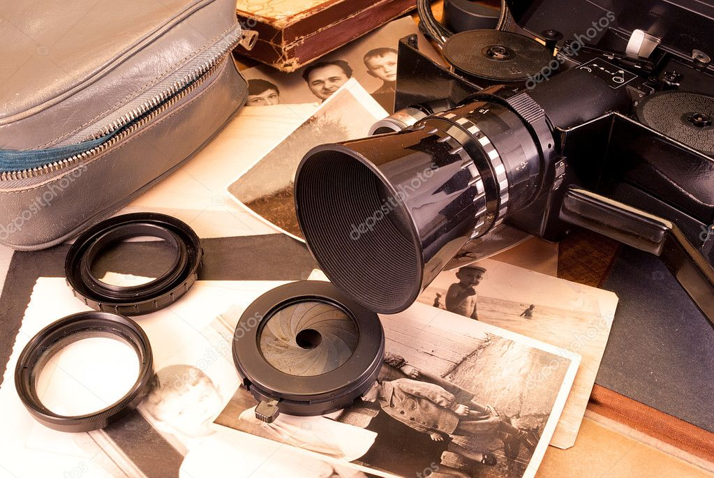 Vintage video camera, accessories and old photo.  Stock Photo #6691688