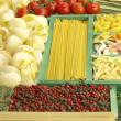Pasta collection in wooden box and ingredients — Stock Photo