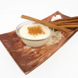 Creamy rice pudding with cinnamon — Stock Photo
