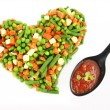 Stock Photo: Heart of a frozen mixed vegetables
