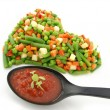 Heart of a frozen mixed vegetables — Stock Photo