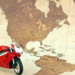 Motorcycle over world map — Stock Photo