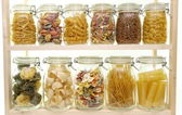 Glass jar filled with pasta — Stock Photo