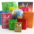 Stock Photo: Shopping bags around of world globe