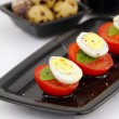 Quail eggs and tomatoes — Stock Photo