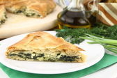 Homemade puff spinach pie with filo pastry — Stock Photo