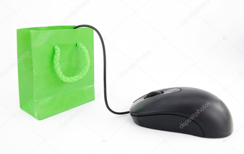 Computer mouse connected to a green shopping bag  Stock Photo #5763931