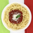 Spaghetti over Italian flag colors background — Stock Photo