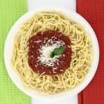 Spaghetti over Italian flag colors background — Stock Photo