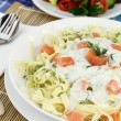 Tagliatelle pasta with cream, salmon and anise - Stock Photo