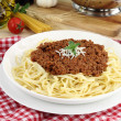 Bolognese pasta with cheese and basil - Stock Photo