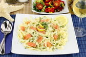 Tagliatelle pasta with salmon, anise and lemon — Stock Photo