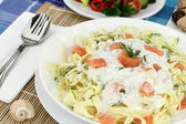Tagliatelle pasta with cream, salmon and anise — Stock Photo