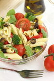 Penne pasta salad with vegetables and herbs — Stock Photo