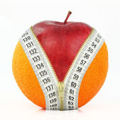 Fruits and diet against fat — Stock Photo