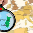 Magnifying glass over a map of Portugal — Stock Photo