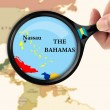 Magnifying glass over a map of the Bahamas - Stock Photo