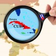Magnifying glass over a map of Cuba — Stock Photo