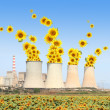 Sunflowers come out from chimneys of a power plant - Stock Photo