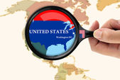 Magnifying glass over a map of United states — Stock Photo