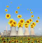 Sunflowers come out from chimneys of a power plant — Stock Photo