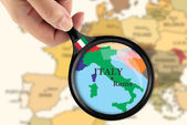 Magnifying glass over a map of Italy — Stock Photo