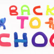 Plasticine figures and letters spelling back to school — Stock Photo