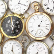 Various Antique pocket watches and a compass — Stock Photo