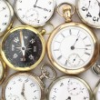 Various Antique pocket watches and a compass — Stock Photo #6529025
