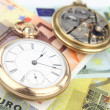 Stock Photo: Antique pocket clock and money