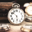 Antique retro silver pocket clock — Stock Photo